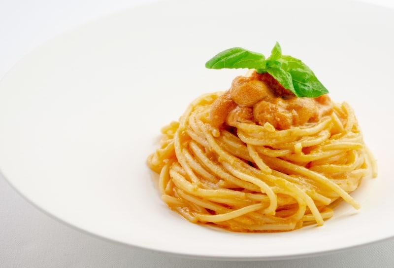 Spaghetti ai Ricci di Mare *Uni, White wine garlic tomato cream sauce arancino at the kahala