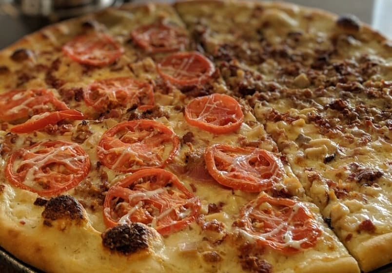 Famous for offering over 100 types of pizza! Choose half and half toppings for the ultimate selection.